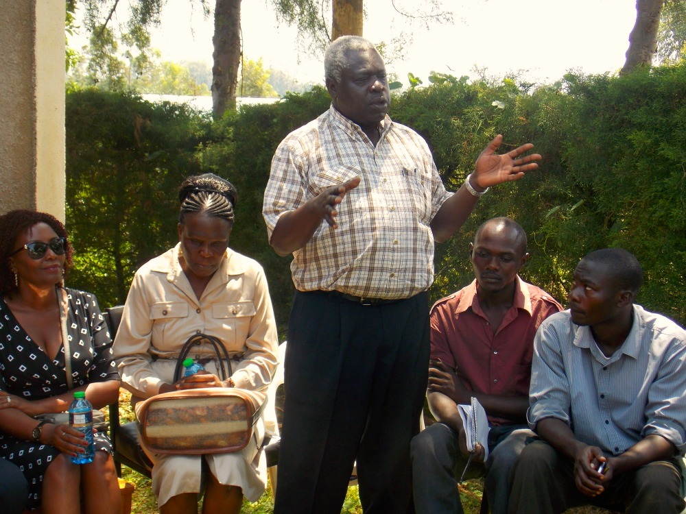 Discussion group of men and women outside health centre in Kenya.