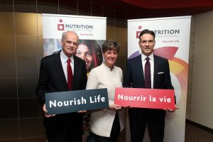 David de Ferranti, Chair of the Board of Results for Development and Nutrition International, the Honourable Marie-Claude Bibeau, Canada's Minister for International Development and La Francophonie, and Joel Spicer, President and CEO, Nutrition International.