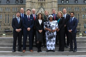 Nutrition International board members pose in front of the Parliament building.