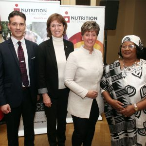 Joel Spicer, President and CEO of Nutrition International stand with Pam Damoff, Liberal Member of Parliament; the Honourable Marie-Claude Bibeau, Minister of International Development and La Francophonie; and Her Excellency Dr. Joyce Banda, former President of Malawi.