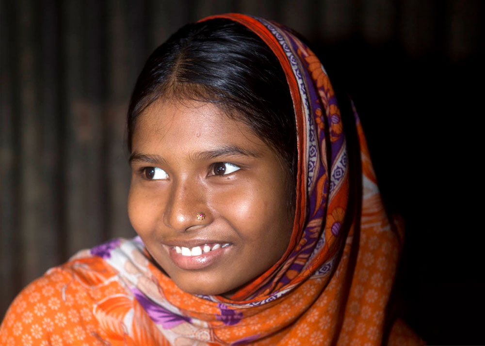 Happy, 15, is pregnant and lives in a slum of Dhaka, Bangladesh.