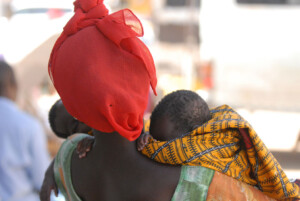 A woman in Senegal with her two babies