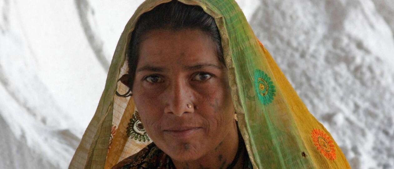 woman in gujarat in front of salt pile