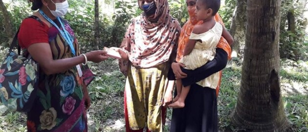A Family Welfare Assistant in Bangladesh helps disseminate health promotion messages to women in the community.