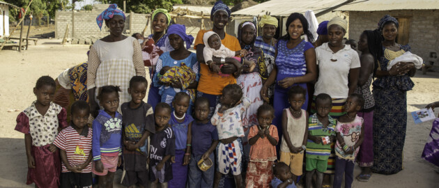 group of standing and smiling women and children in senegal