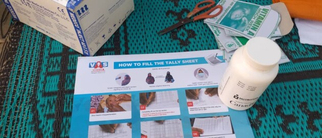 Vitamin A tally sheet sits on a table as one of the job aids on display at a Child Health and Nutrition Week event in Nigeria