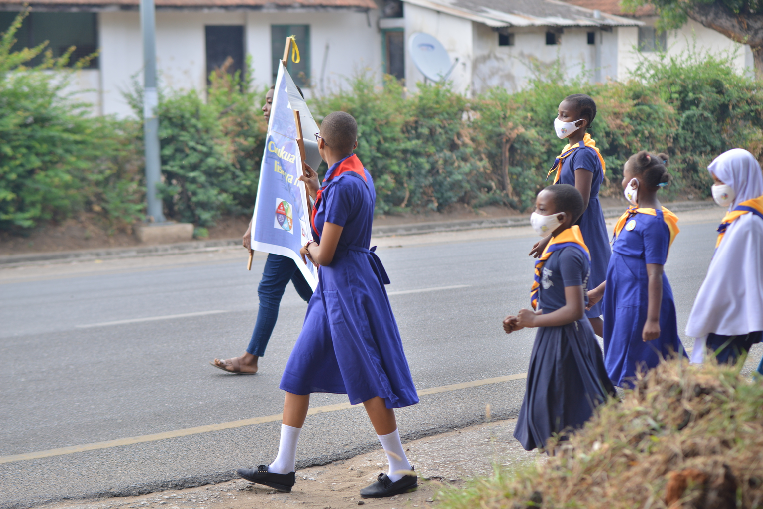 Girls marching in an awareness walk in Tanzania to raise awareness around adolescent nutrition.
